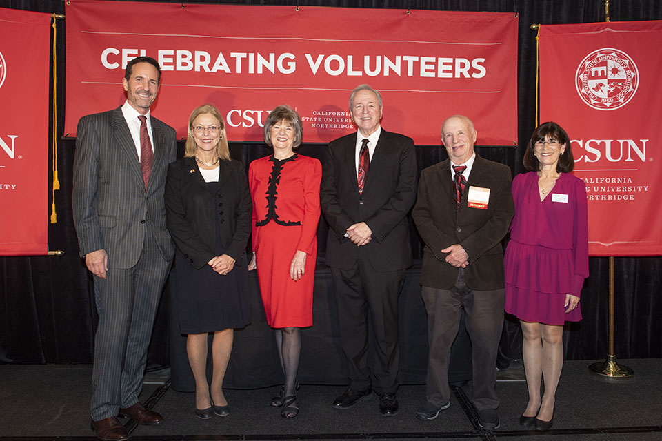 Steven Oppenheimer (second from right) with fellow awardees Earl Enzer, Bonnie Faherty, and Edward Feldman, and CSUN President Dianne F. Harrison and Alumni Association President Cindy Chernow at the Volunteer Service Awards. (Photo via CSUN Today.)